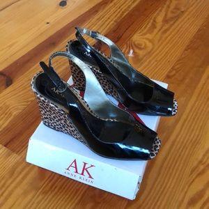 Black Anne Klein peep toe wedges. Size 10